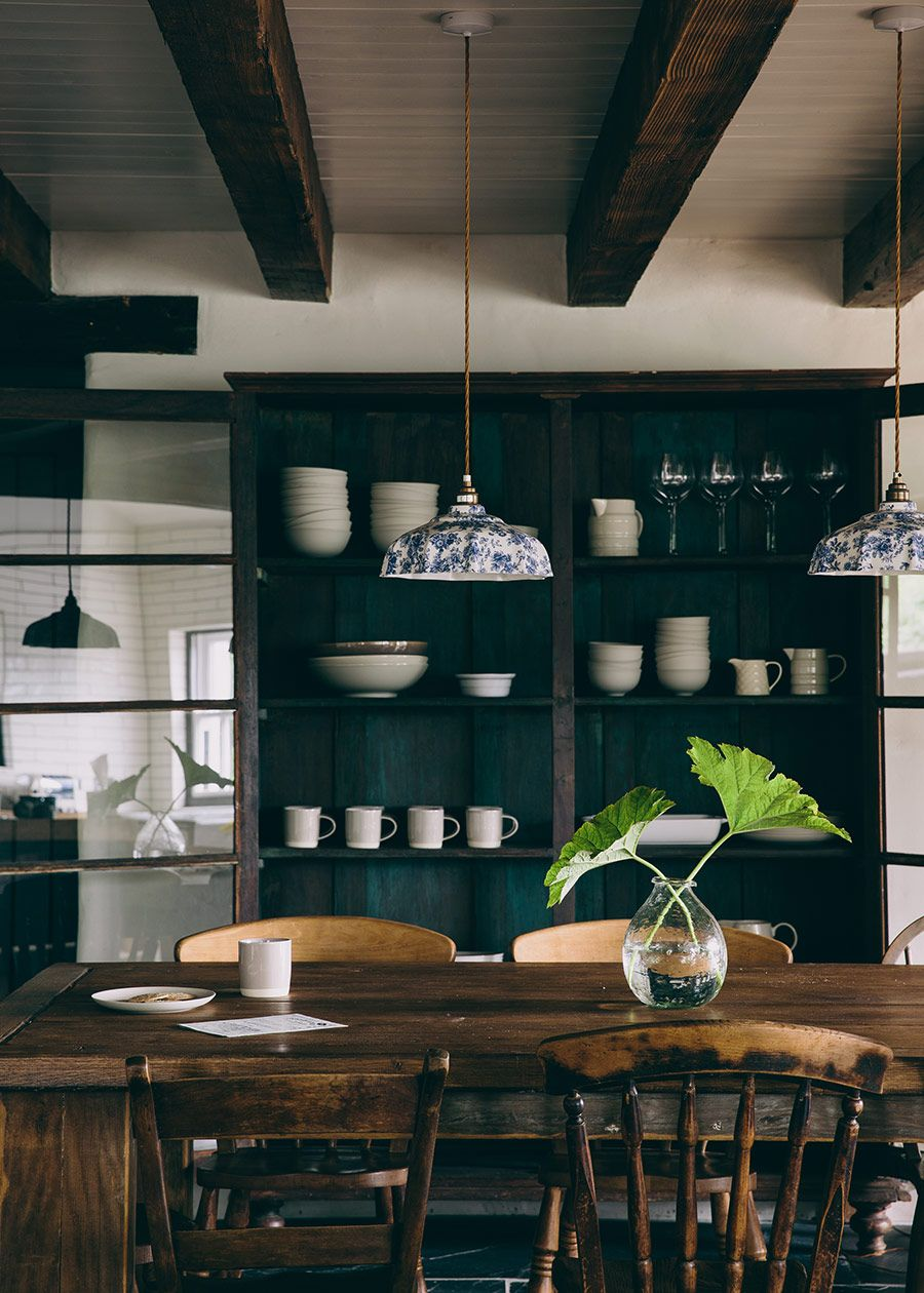 dark green cupboards and beautiful china inspired pendants in this ...