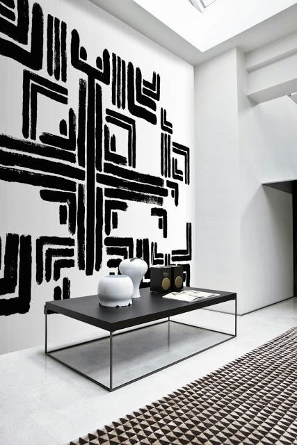 Black And White Walls black and white geometric art on the wall. rug with black and