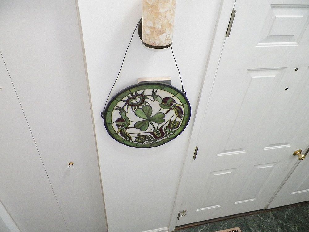 Foyer fixture I hate it- but no money- stained glass love it- no place