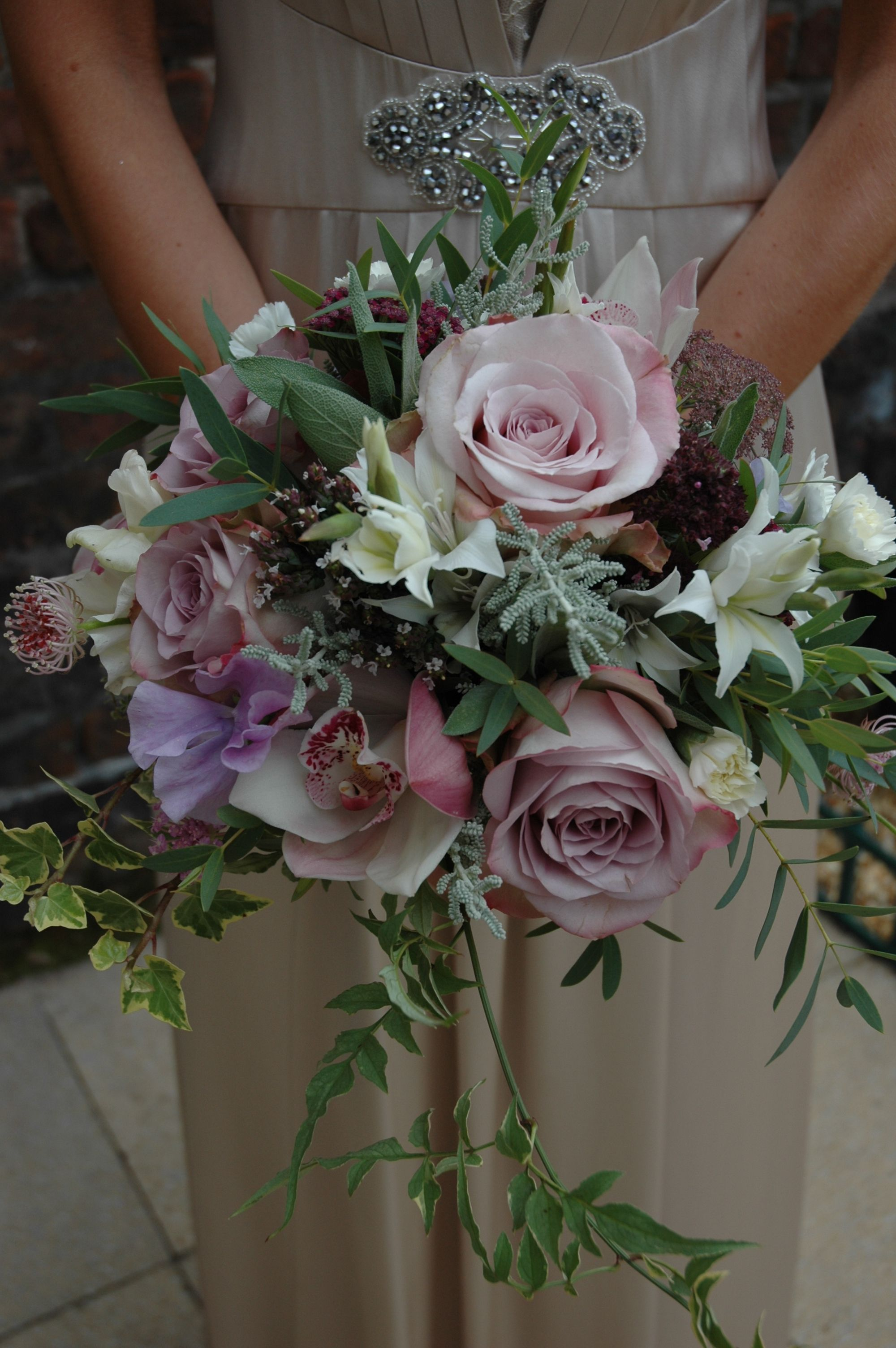 Orchid, jasmine and rose bridesmaid's posy