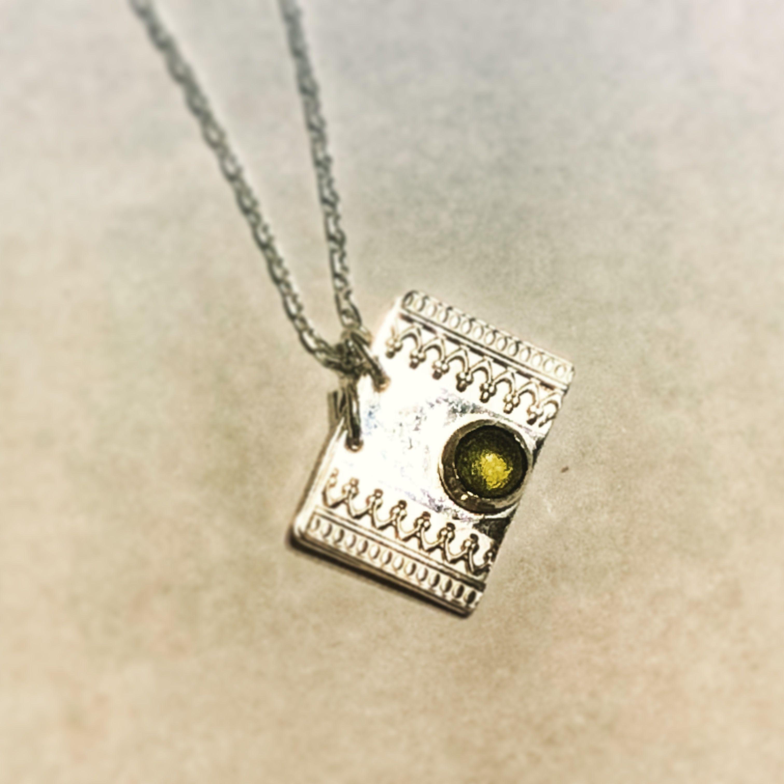 A new uminspirationalu pendant sterling silver bezel set peridot