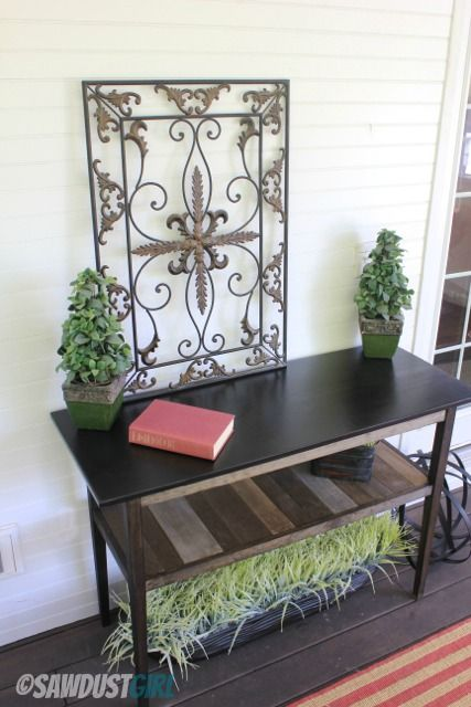 DIY Console Table - love how the boards on the middle shelf are stained different colors!