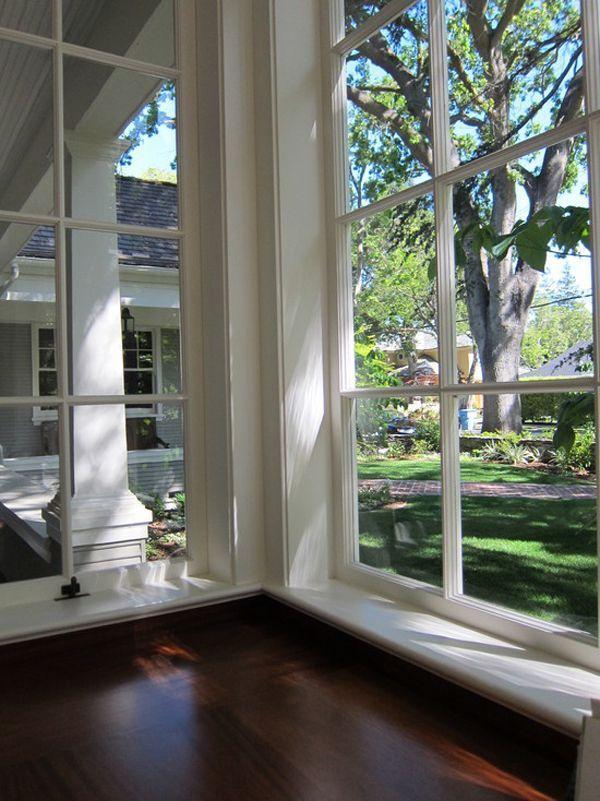 I love the huge windows and dark wood floors sunroom - Ceiling to floor windows ...