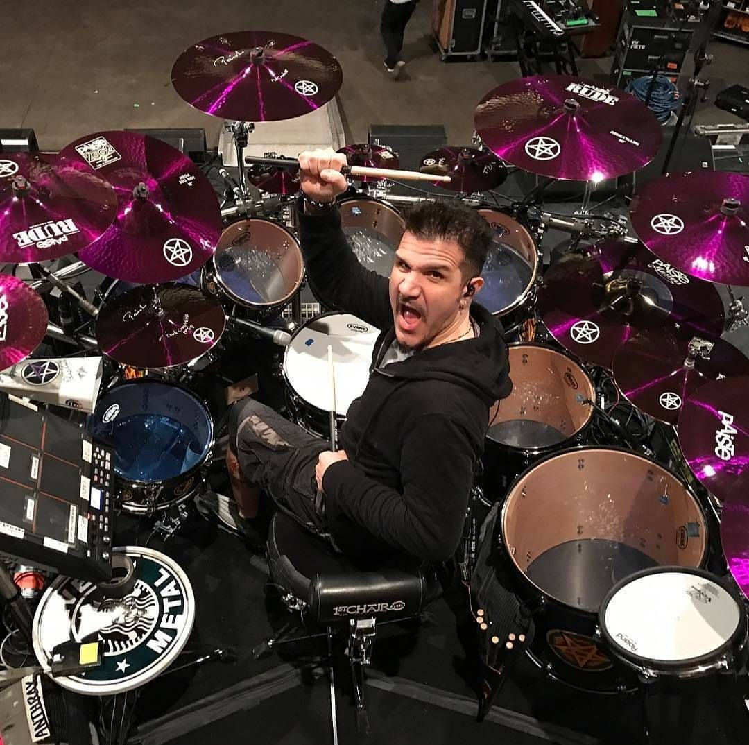 Professional musician Charlie Benante playing drum