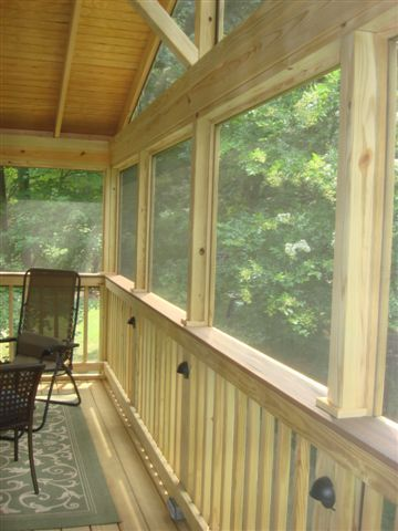 Inside Screened Porch With Posts Unwred And Wood Railings
