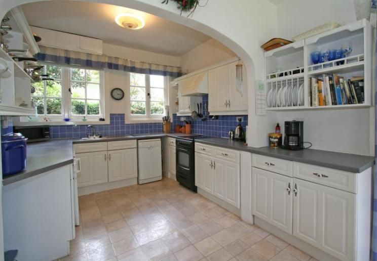 Lovely Photo Of Beige Blue White Kitchen With Tiled Tiles Lino And Plate Rack
