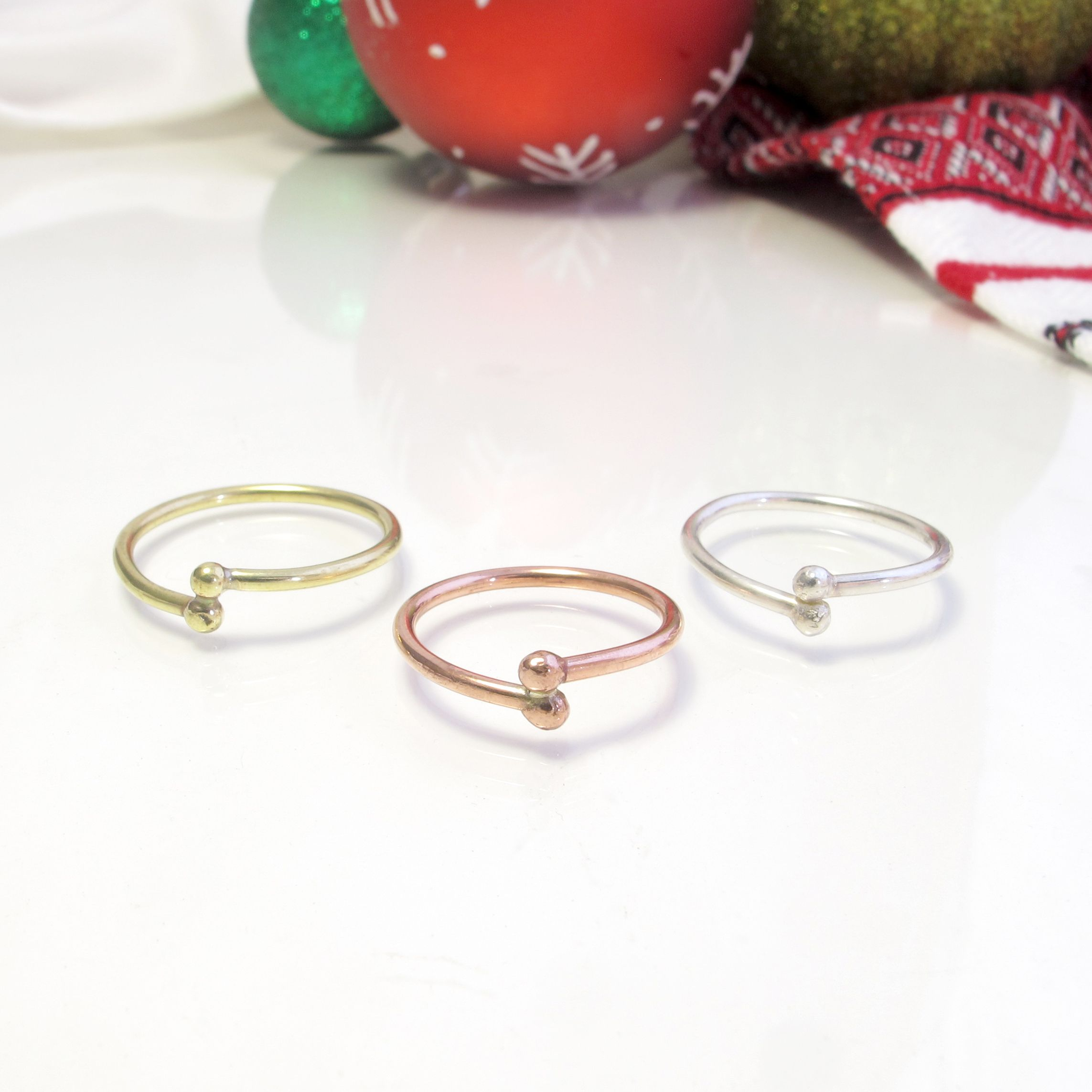 Christmas is here, bring good cheer! 🌟 Sweet little stacker rings ~ perfect solo, or great layered with other rings. #ootd #ootn #layeredrings #stackerrings #stackingrings #simplerings #cuterings #littlerings #tinyrings #petiterings #plainrings #baublerings #layerings #mixnmatchrings #ringsringsrings #ringintheholidays #christmasishere #stockingstuffers #littletreasures #cutejewelry #cutejewellery #ballrings #wholesalehandmaderings #boutiqueshopping