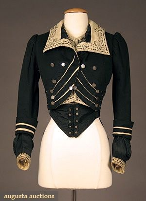 HIGH STYLED BLACK WOOL BODICE, c. 1900 Black & cream wool felt w/ contrasting black & cream embroidery & soutache, silver military style buttons. Front