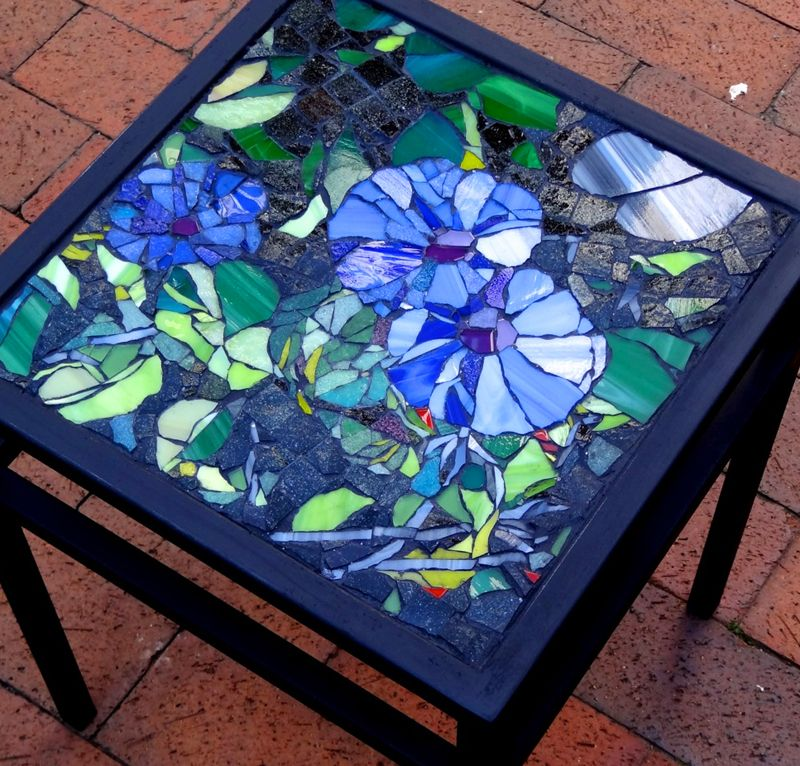 Glass mosaic morning glory on wrought iron table