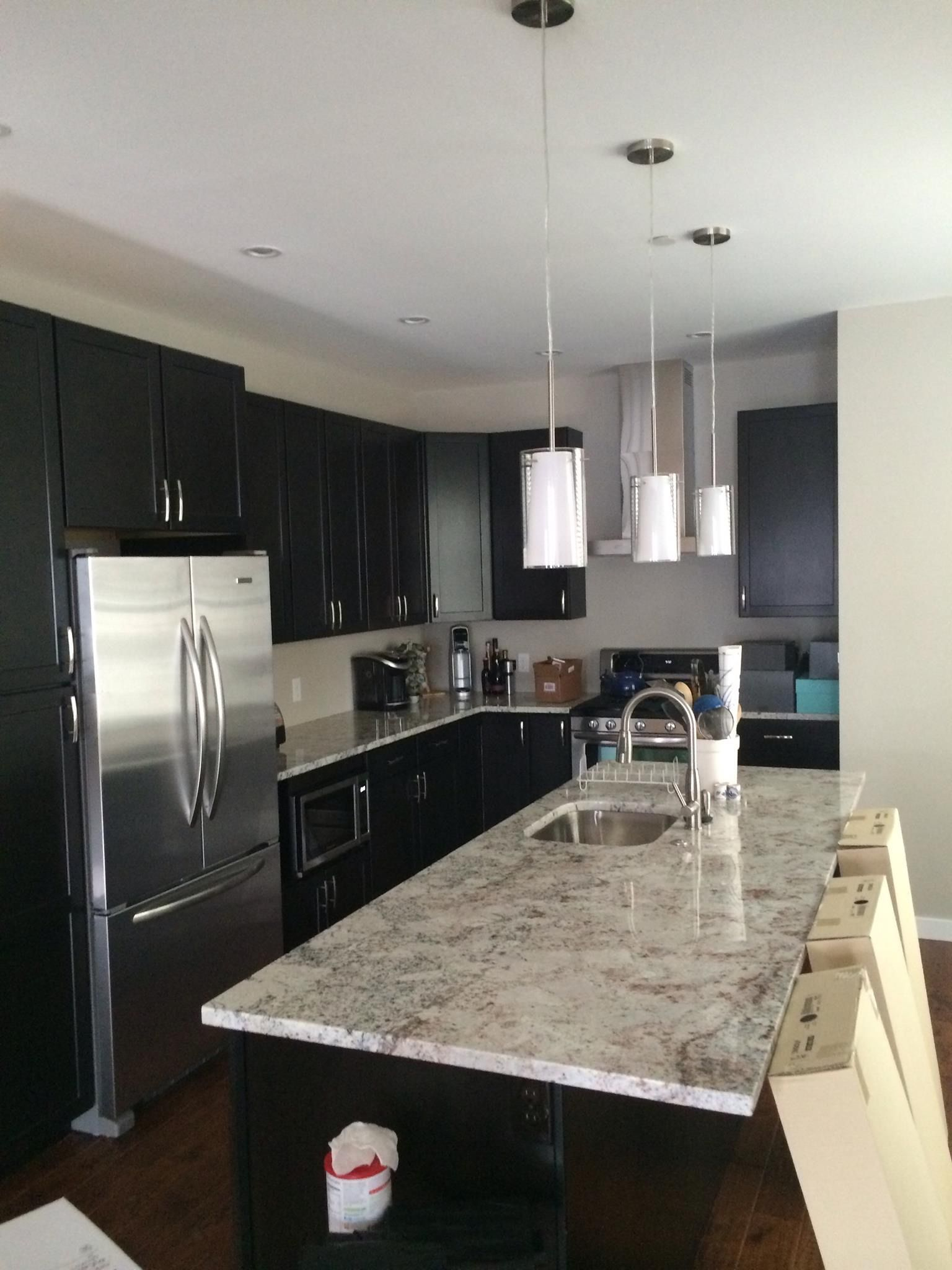 White Galaxy granite kitchen countertop with eased edge detail ...