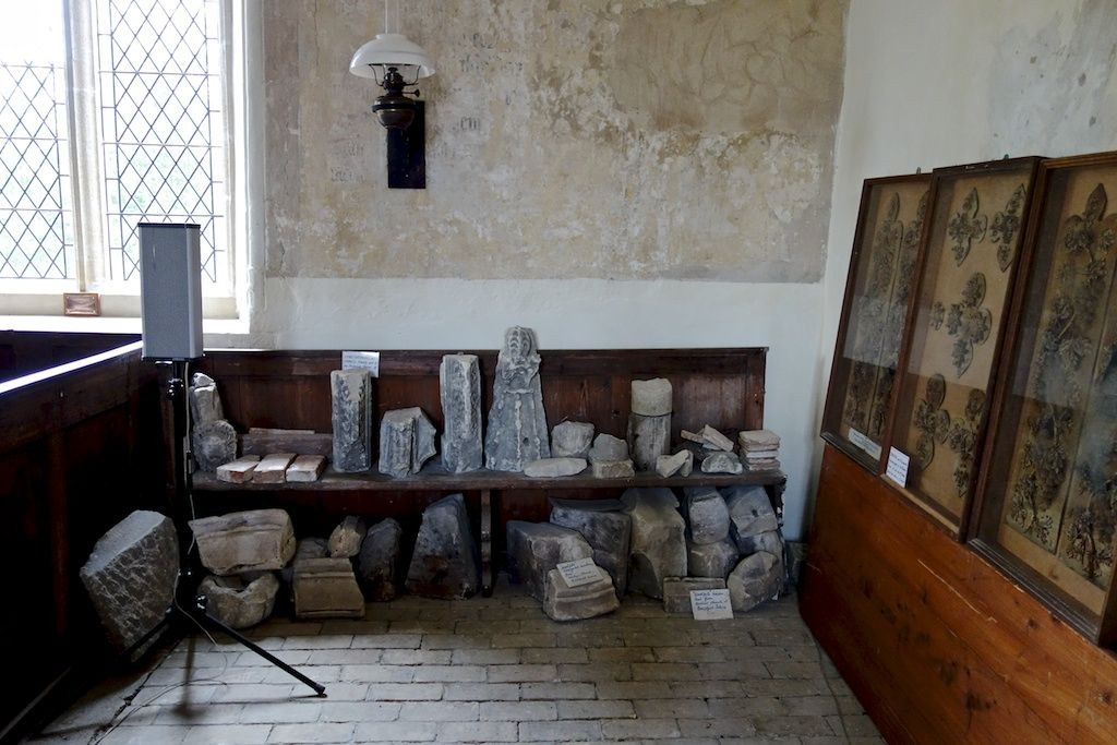 Church in Essex with the bits that have fallen off it and on the right very fine Essex straw work which I think used to be behind the altar. Nice oil lamp, wall painting and great sound system.