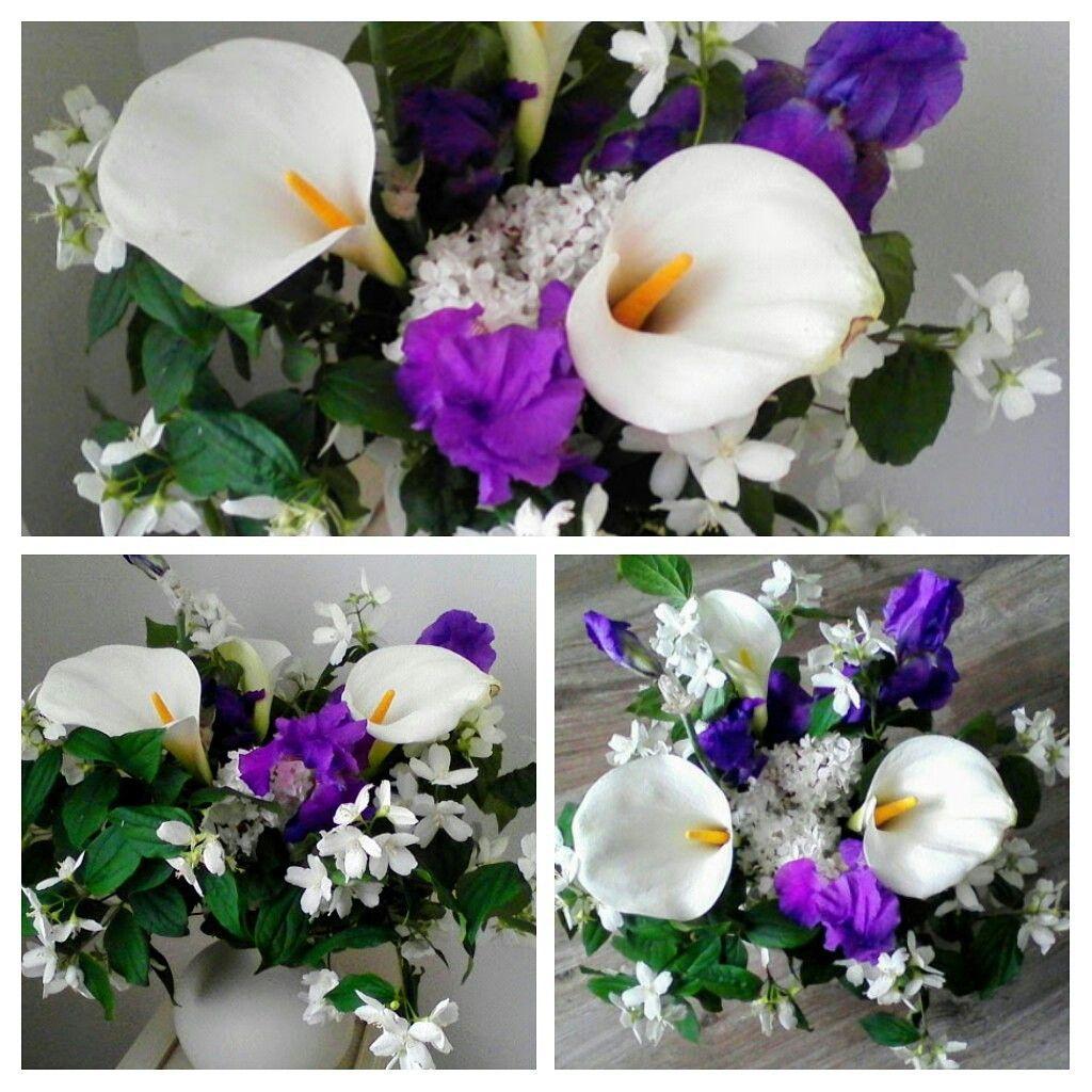 bouquet d'iris, de seringat, d'arums et lilas blancs, très parfumé