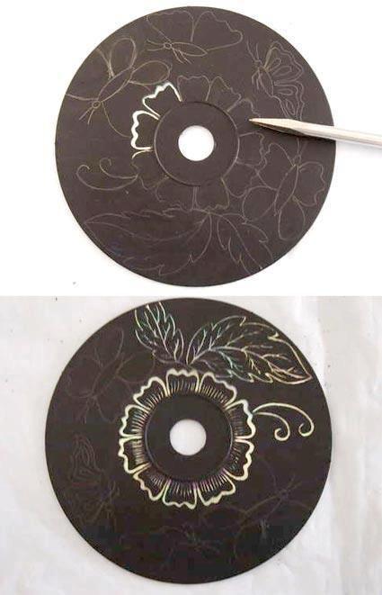 Måla färg på CD-skiva skrapa fram mönster.