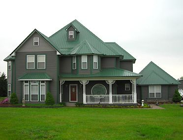 Green Metal Roof With Dark Grey Siding Color House And