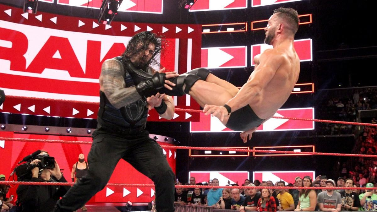 Photos The Hounds Of Justice Lay Waste To Mr Monster In The Bank Braun Strowman The Shield Reunite Finn Balor