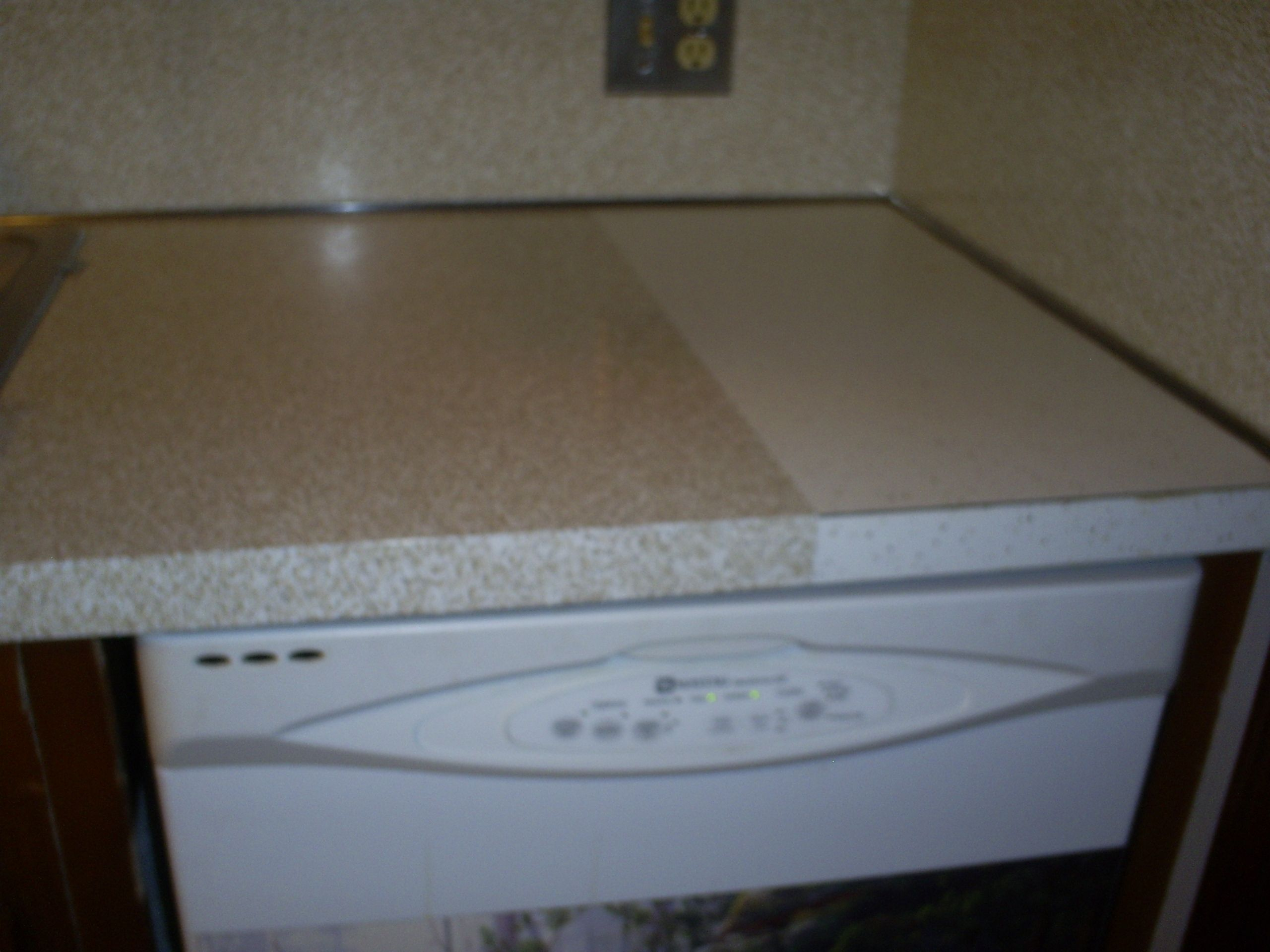 kitchen counter before and after, contact paper! (with