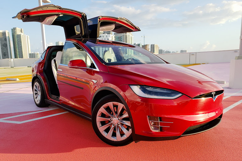 Rent A Red Tesla Model X In Miami Getaround Tesla Car Tesla Model X Tesla Suv