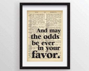 """Hunger Games Trilogy Effie Trinket Quote """"And may the odds be ever in your favor."""" - Recycled Vintage Dictionary Art Print"""