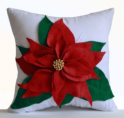 Poinsettia decorative throw pillow cover in red and green felt on white cotton cushion cover. This Christmas pillowcase makes a great gift for Christmas, Christmas decor and is available in all sizes.