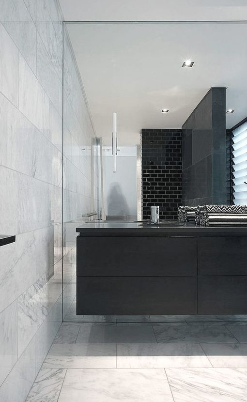 Adams Architects bathroom floating vanity black subway tile