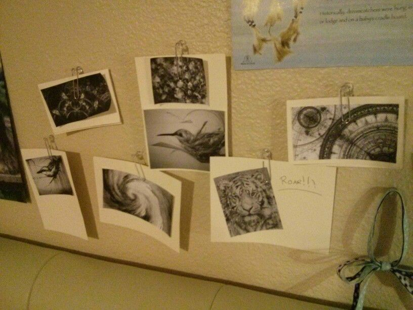 Use large paper clips and tacks ti hang up your pictures!!!