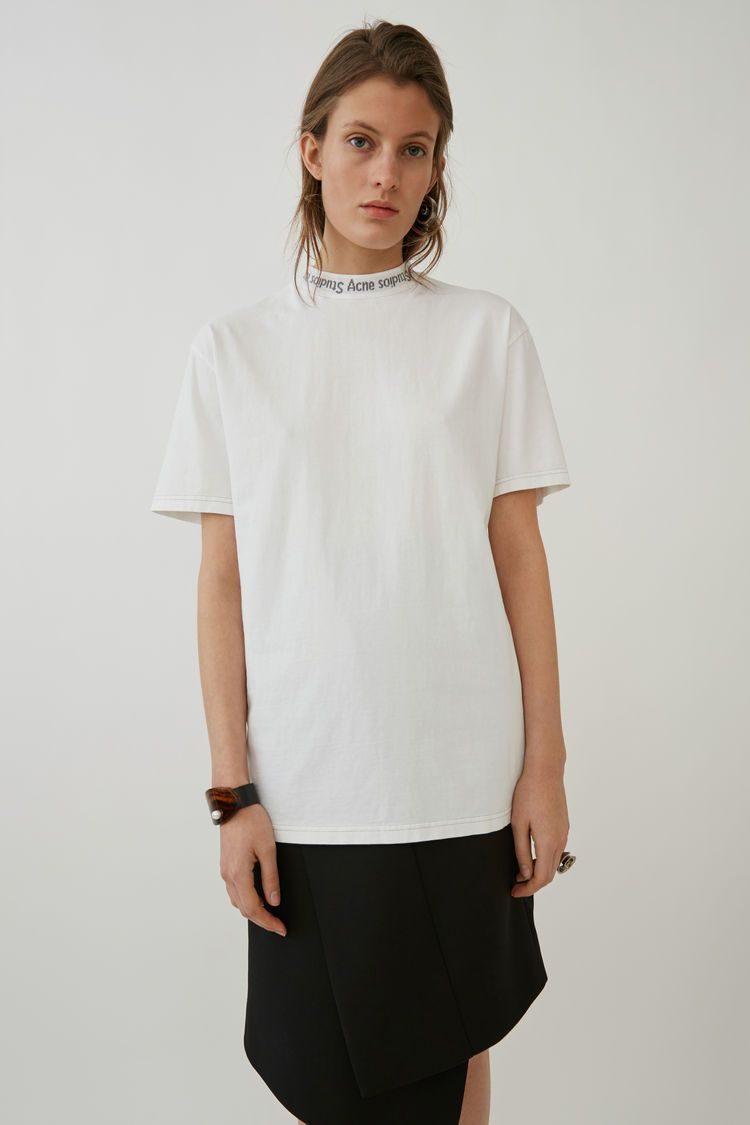 3e79e235fbba Acne Studios Gojina Dyed white is a comfortable, oversized, overdyed  t-shirt.