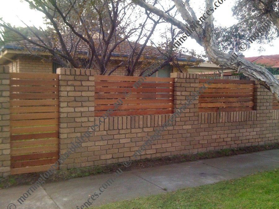 fence on top rock wall masonry fence walls and retaining walls - Brick Wall Fence Designs