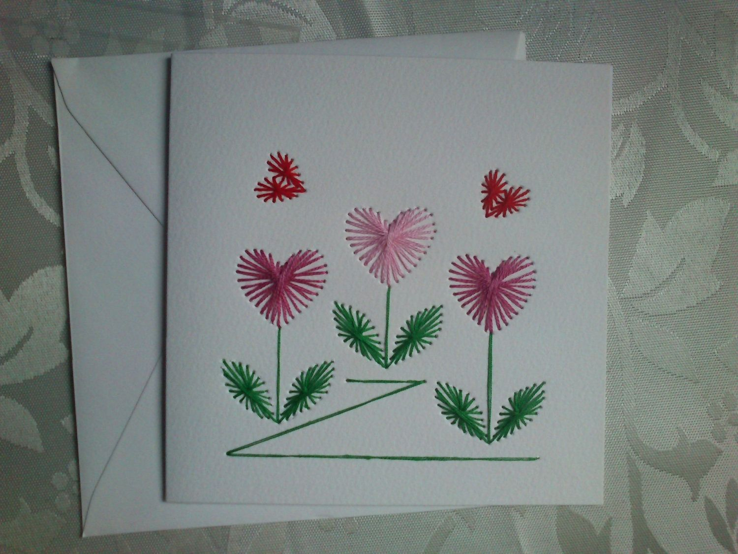 Paper Embroidery Greeting Card. Hearts design on a white
