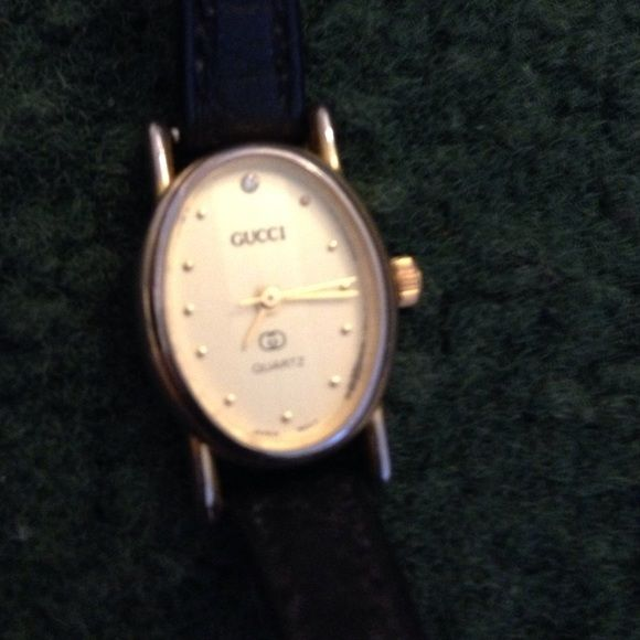 GUCCI WATCH gold hardware & leather band VINTAGE TIME PIECE. Gucci symbol on back   Japan mont. Inscribed in back a Paris 18k Gucci Accessories Watches