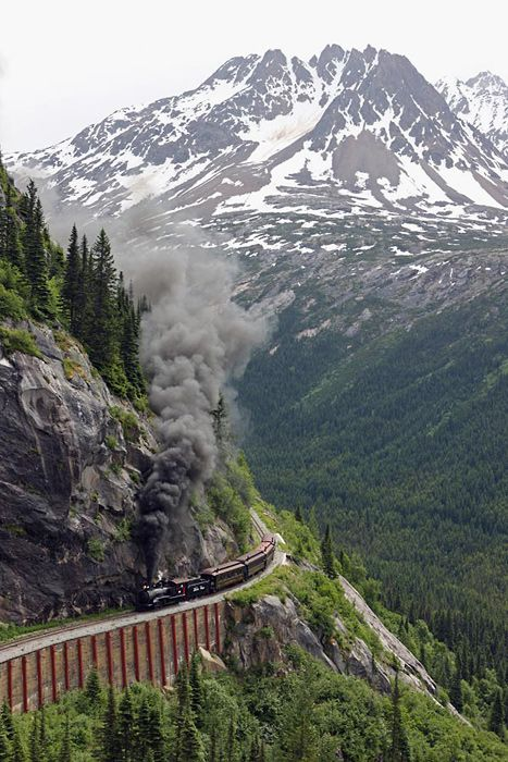 Mountain Rail, Yukon - Alaska. Can I count this as a place I've been? We drove from Alaska to the Yukon and back into Alaska...and followed the route of this train. We SAW this train but they were getting it ready for the summer season, so we didn't actually ride it. We drove right past where this picture was taken though.    This view is breathtaking!