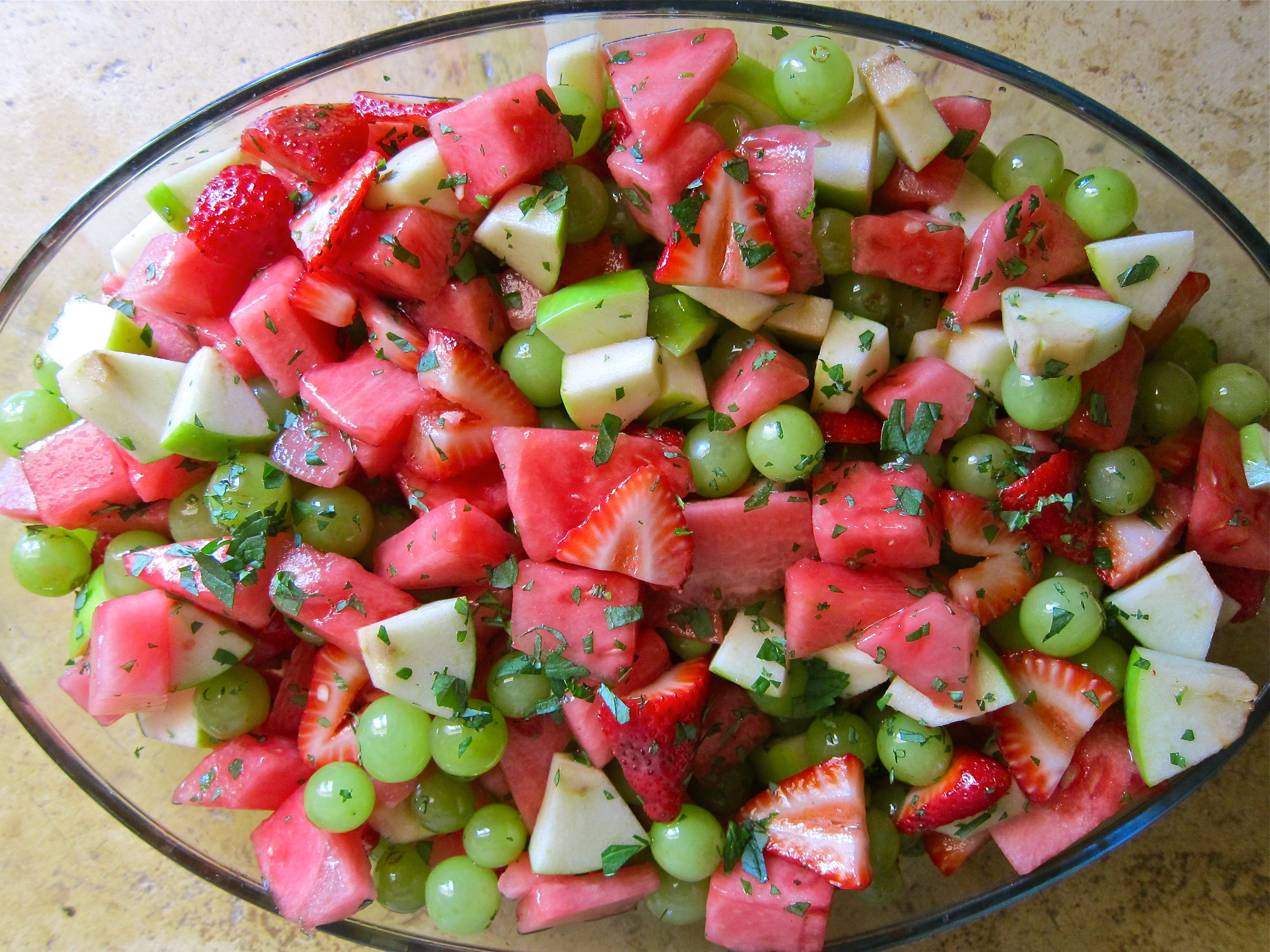 Pink And Green Fruit Salad Watermelon, Green Grapes, Strawberries, And