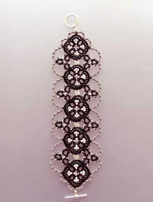 Bello - smukt armbånd i sort og sølv ??