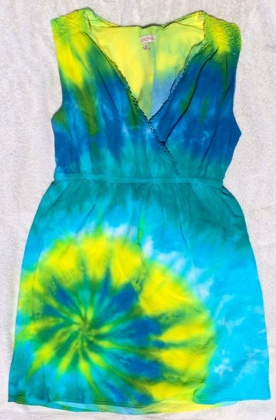 This bright, blue and yellow tie-dye dress was hand dyed with love in Austin, TX on a brand new 100% cotton Merona (Target brand) sundress. Its a nice dress that has an inner lining and lays really well on with an empire waist. Merona 100% cotton sundress. Size Medium.  $25