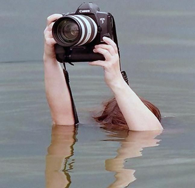 World Photography Day 50 Crazy Things Photographers Do To Get The Best Shot Photographer Humor Funny Photography World Photography Day