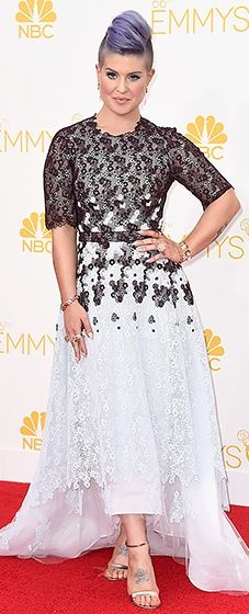Kelly Osbourne wore a high-low gown with an embellished bodice at the 2014 Emmys. The black and white compliments her lavender hair!