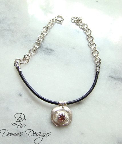 """7.5"""" bracelet had a hand made sterling silver Clay disk with a Faceted Pink Gemstone on a 3"""" section of leather cord, chain is hand linked."""