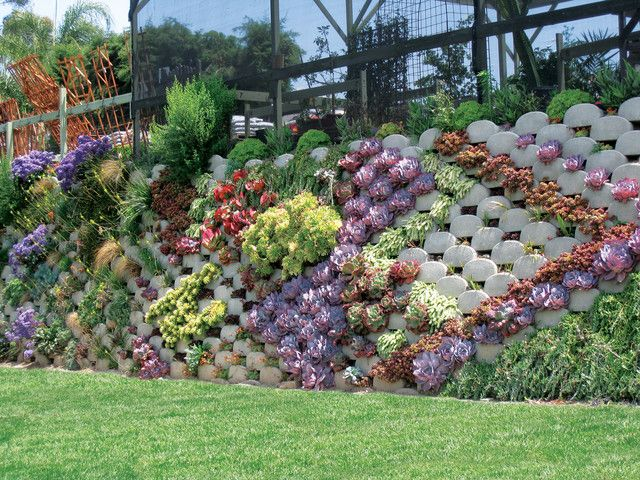 Putting Your Flower Pot On A Stand Will Create A Statement There Are Various Diy Plant Stand Idea Sloped Garden Backyard Retaining Walls Retaining Wall Blocks