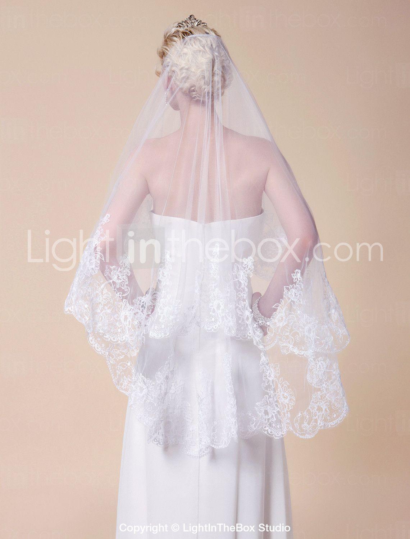 Twotier fingertip length wedding veil with lace applique edge