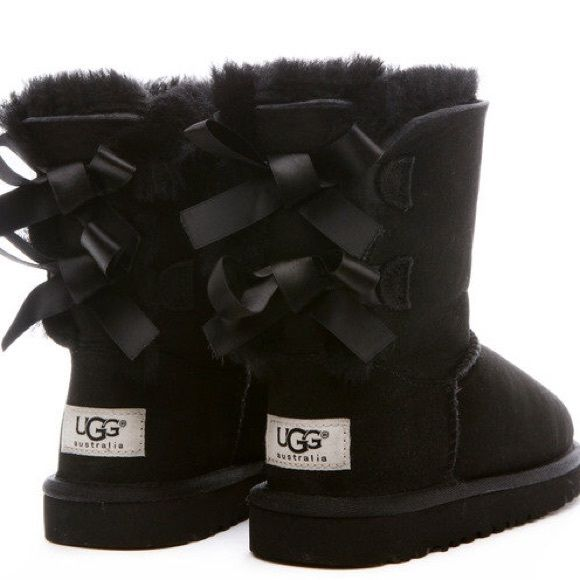 Cute like new black Ugg boots with bows on the back. Worn a few times but in excellent condition! Perfect for Christmas. Size 3 in kids, equivalent to ...