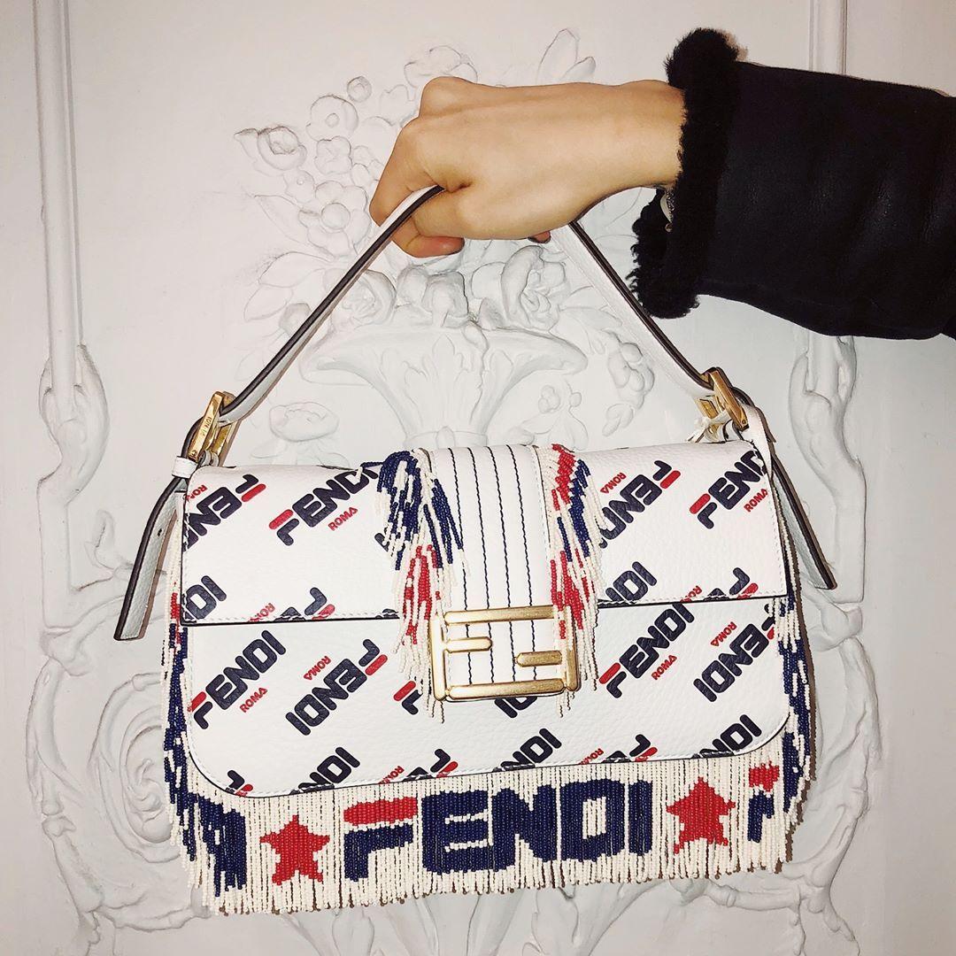 63c514f06a0f ON THE FRINGE ♥ Don t miss the  fendi baguette  FendiMania beaded fringe  shoulder bag now in store on our Main Floor and online at BG.com.