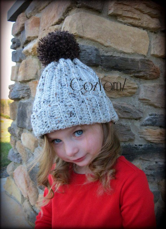 e6d08e2d569 Cream and brown speckled stocking hat with faux fur poof on top ...