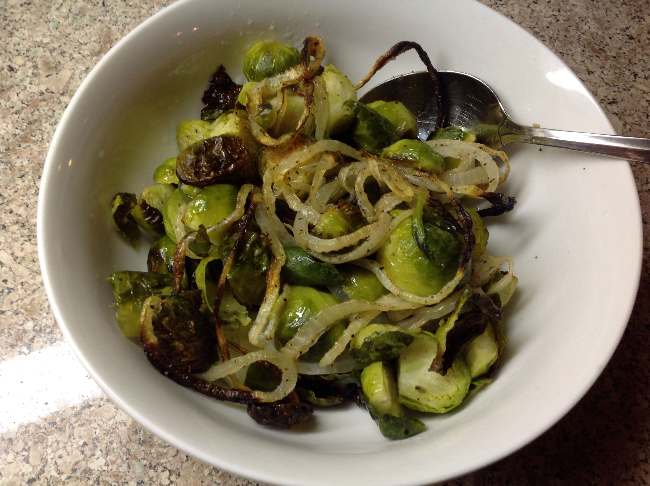 Simple Paleo dinner tonight: Brussels sprouts and onion, tossed with olive oil, little salt and pepper, baked at 450 for 25 min.