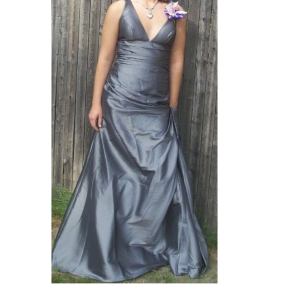 Silver/grey prom dress Silver/grey prom dress. Worn once to my prom a few years ago. It does have a small pin that is meant to go on the front but I don't have a picture of it right now but I can get one soon! I wore it in the back because it was a little big for me, I didn't have time to get it fitted. Dresses