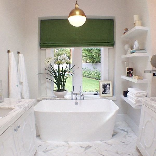 Modern Freestanding Tub With Tub Filler Faucet Below Garden View