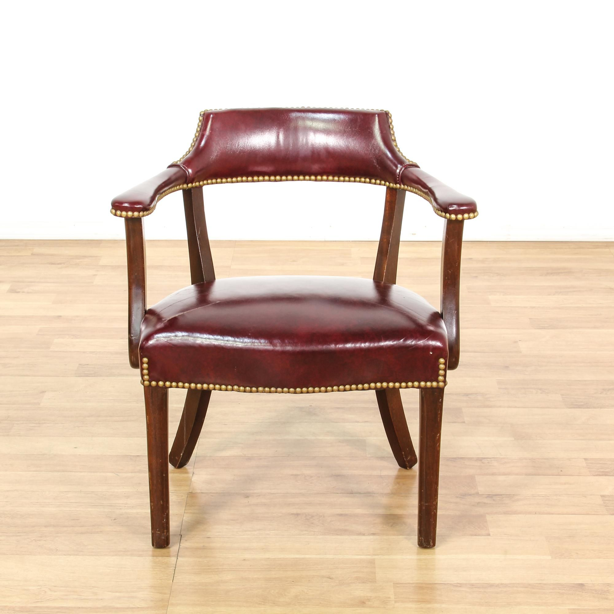 This captain s chair is upholstered in a durable faux leather