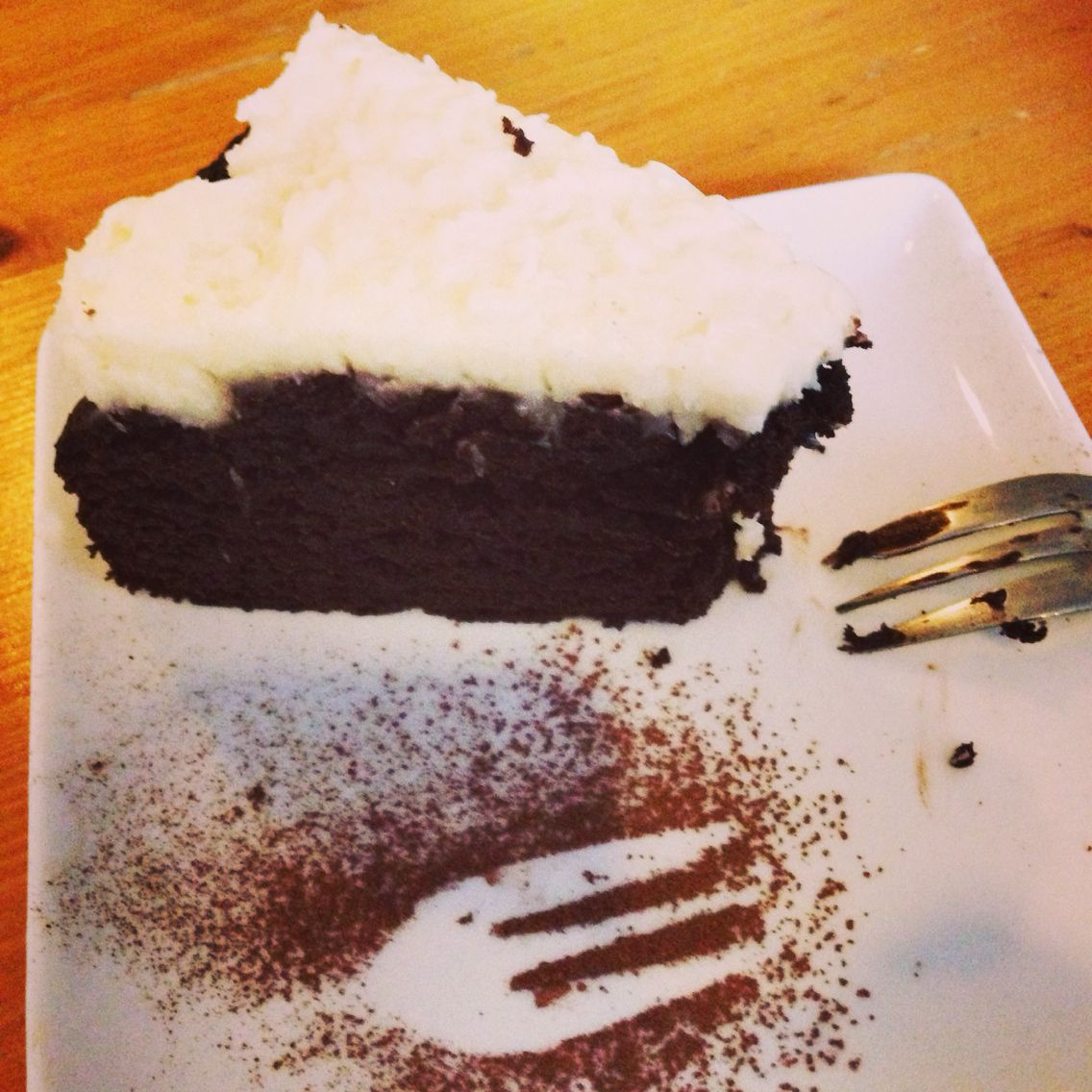 A piece of chocolate with cream cheese coconut topping heaven at KEEK.