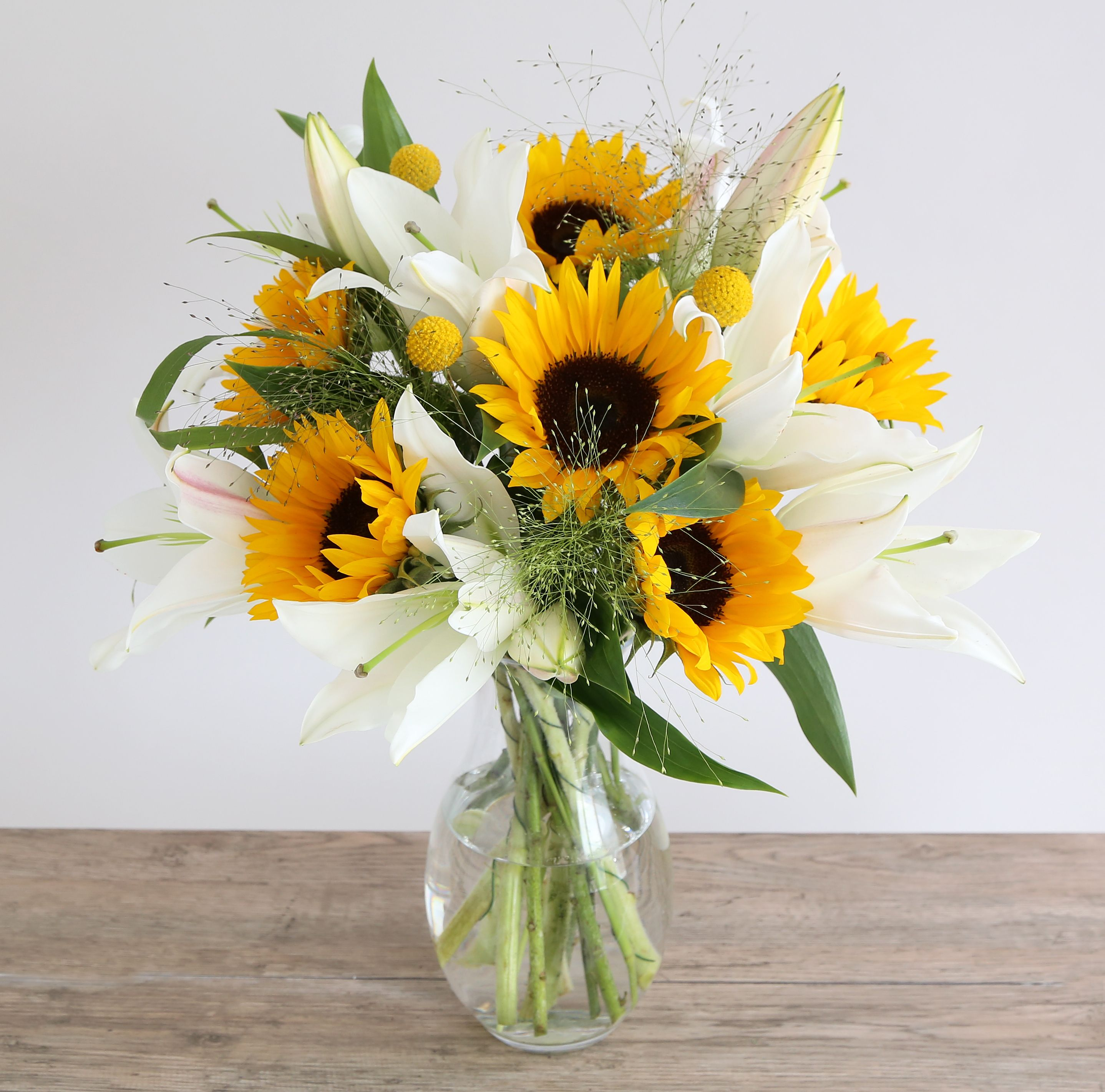 Hello pinteresters sierras bridal dreams pinterest wedding sunflower lillies bouquet 6 sunflower 3 white oriental lily 3 panicum 3 craspedia izmirmasajfo