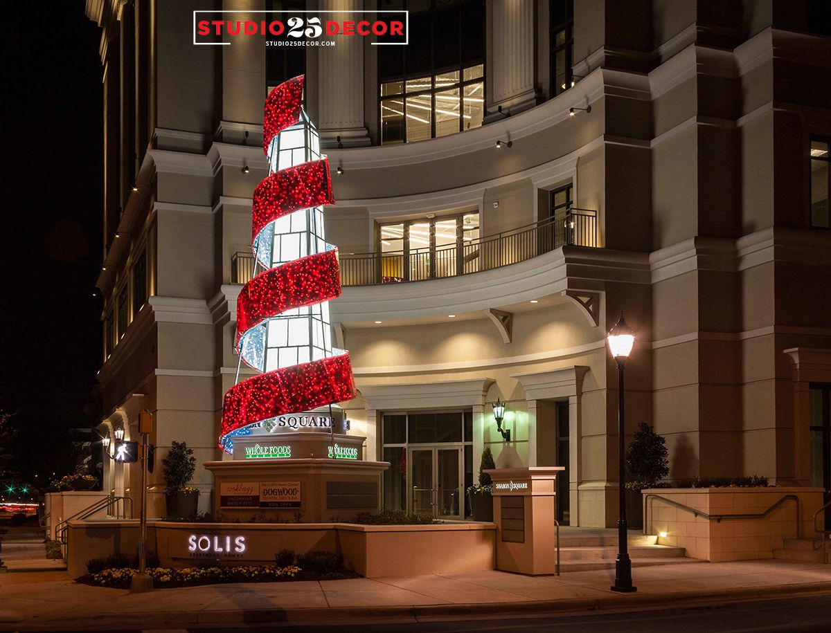 Studio 25 Decor created this custom wrapped ribbon around an existing obelisk statue for a one-of-a-kind holiday display.