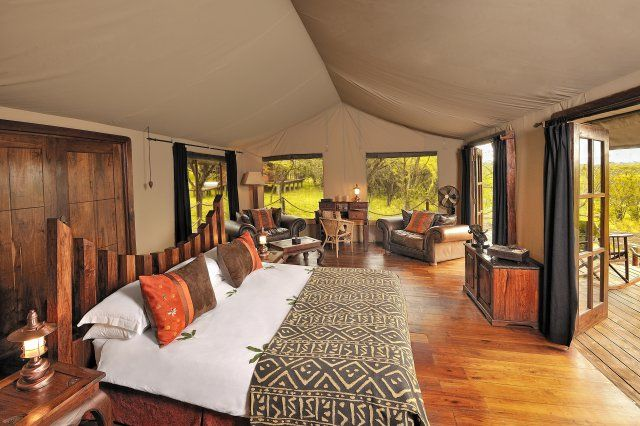 Serengeti migration camp tanzania 20 luxurious tents located next to the famous grumeti river which are home to resident hippos that bark and wallow their