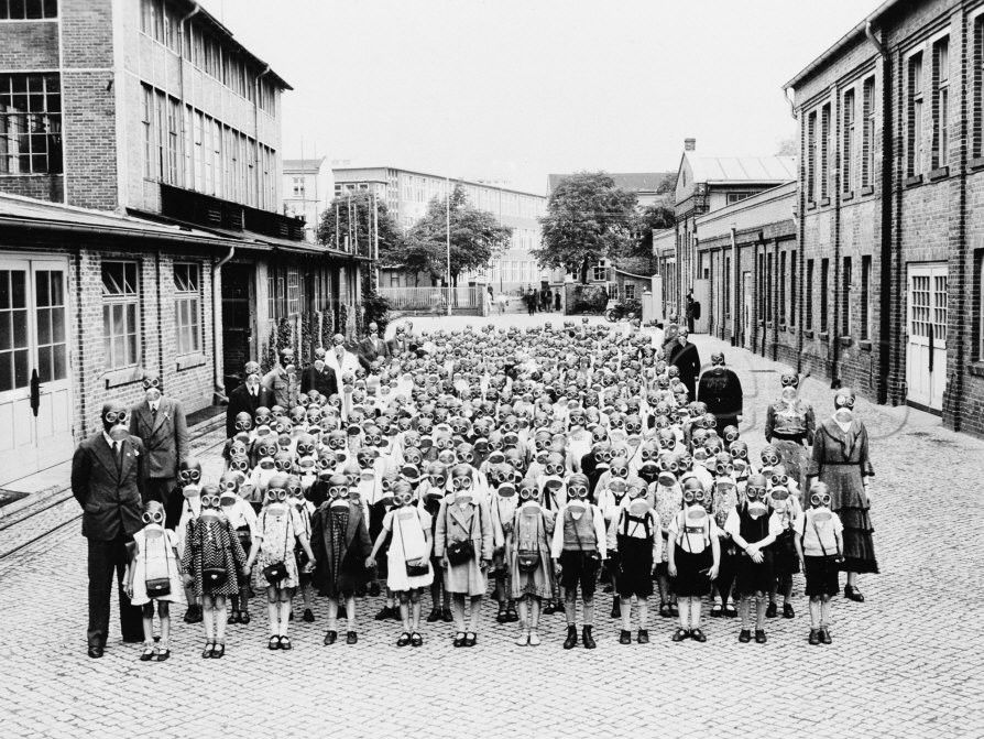German School Teachers and Children Wear Gas Masks as they are Drilled